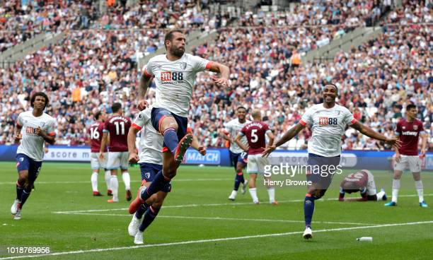 Steve Cook of AFC Bournemouth celebrates scoring his team's seond goal during the Premier League match between West Ham United and AFC Bournemouth at...