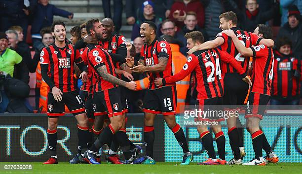 Steve Cook of AFC Bournemouth celebrates with team mates as he scores their third goal during the Premier League match between AFC Bournemouth and...