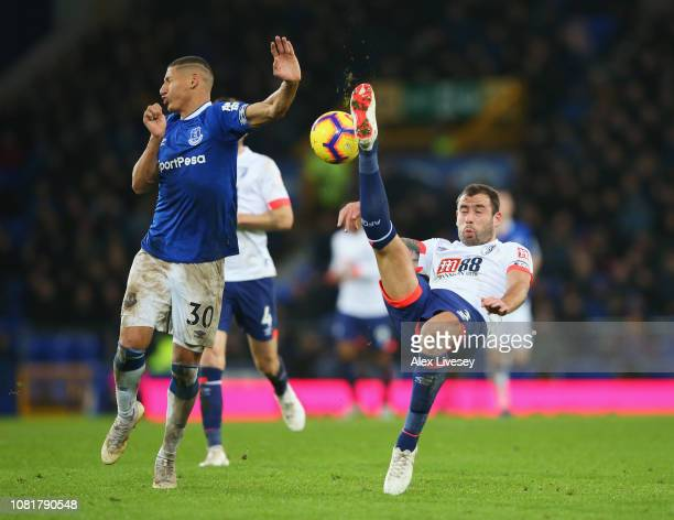 Steve Cook of AFC Bournemouth clears from Richarlison of Everton during the Premier League match between Everton FC and AFC Bournemouth at Goodison...