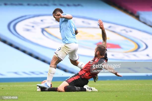 Steve Cook of AFC Bournemouth collides with Gabriel Jesus of Manchester City during the Premier League match between Manchester City and AFC...