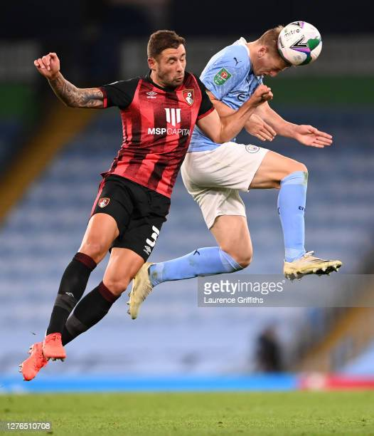 Steve Cook of AFC Bournemouth collides with Liam Delap of Manchester City in the air during the Carabao Cup third round match between Manchester City...