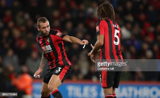 Steve Cook of AFC Bournemouth hands a bit of paper to Nathan Ake of AFC Bournemouth during the Premier League match between AFC Bournemouth and...
