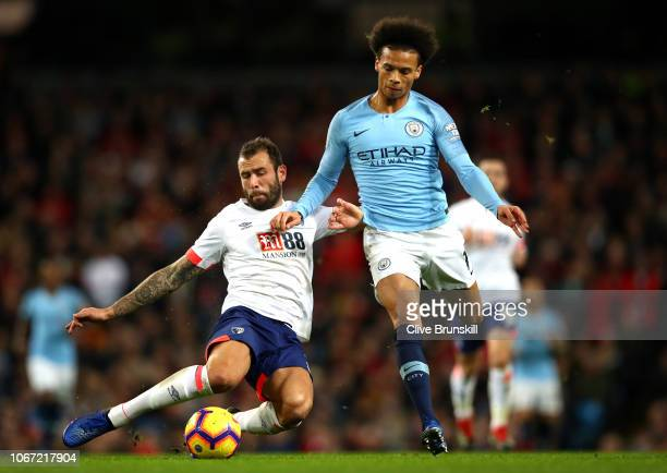 Steve Cook of AFC Bournemouth is challenged by Leroy Sane of Manchester City during the Premier League match between Manchester City and AFC...