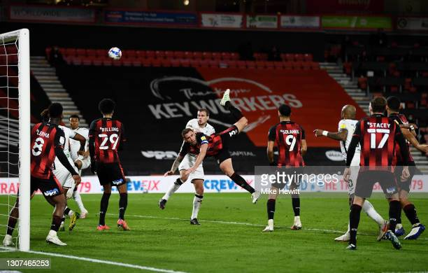 Steve Cook of AFC Bournemouth is challenged by Ryan Bennett of Swansea City in the box during the Sky Bet Championship match between AFC Bournemouth...