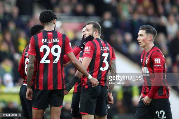 Steve Cook of AFC Bournemouth is consoled by teammates after being shown a red card during the Premier League match between Norwich City and AFC...