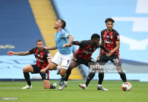 Steve Cook of AFC Bournemouth , Jefferson Lerma of AFC Bournemouth and Lloyd Kelly of AFC Bournemouth battle for possession with Gabriel Jesus of...