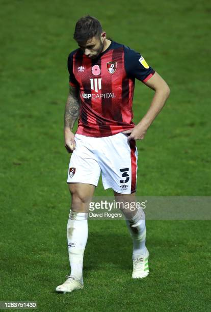 Steve Cook of AFC Bournemouth leaves the pitch after being shown a red card during the Sky Bet Championship match between Sheffield Wednesday and AFC...