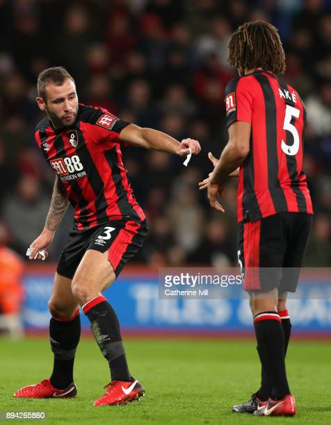Steve Cook of AFC Bournemouth passes a piece of paper to Nathan Ake during the Premier League match between AFC Bournemouth and Liverpool at Vitality...