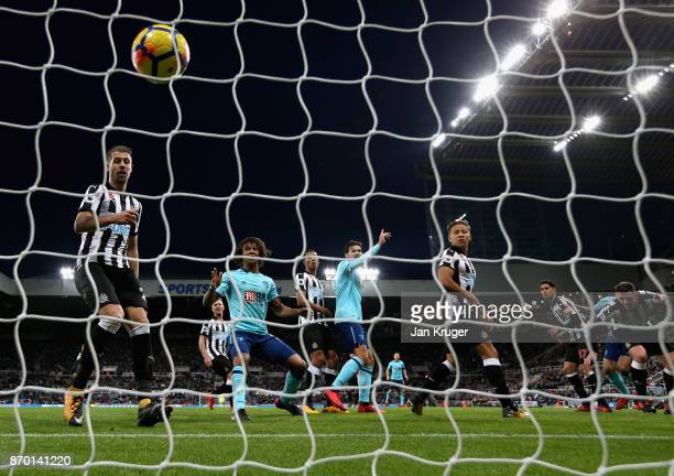 Steve Cook of AFC Bournemouth scores his sides first goal during the Premier League match between Newcastle United and AFC Bournemouth at St James...