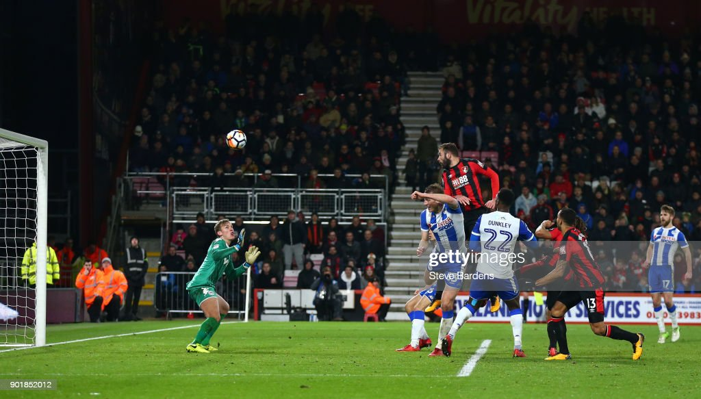 Steve Cook of AFC Bournemouth scores his sides second goal during The Emirates FA Cup Third Round match between AFC Bournemouth and Wigan Athletic at Vitality Stadium on January 6, 2018 in Bournemouth, England.