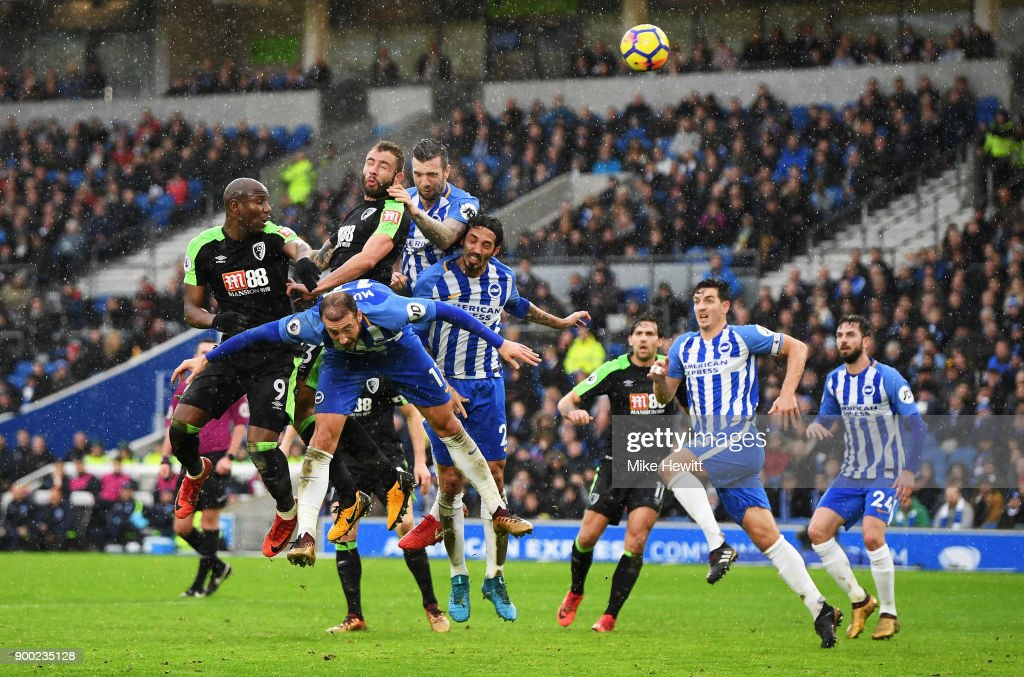 Steve Cook of AFC Bournemouth scores his team's first goal with a header during the Premier League match between Brighton and Hove Albion and AFC Bournemouth at Amex Stadium on January 1, 2018 in Brighton, England.