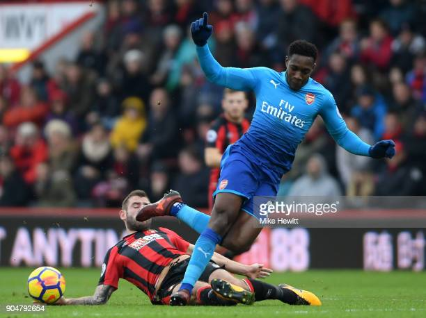 Steve Cook of AFC Bournemouth tackles Danny Welbeck of Arsenal during the Premier League match between AFC Bournemouth and Arsenal at Vitality...