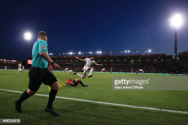 Steve Cook of AFC Bournemouth tackles Marcus Rashford of Manchester United as the linesman looks on during the Premier League match between AFC...