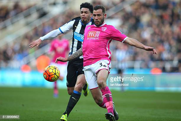 Steve Cook of Bourenmouth vies with Emmanuel Riviere of Newcastle United during the Barclays Premier League match between Newcastle United and AFC...