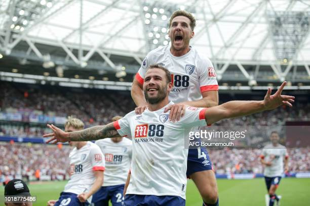Steve Cook of Bournemouth celebrates after scoring a goal to make it 21 with Dan Gosling during the Premier League match between West Ham United and...