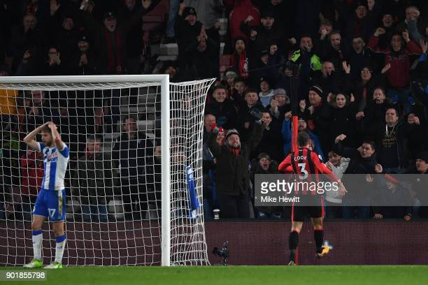 Steve Cook of Bournemouth celebrates after scoring a stoppage time equaliser as Michael Jacobs of Wigan despairs during the The Emirates FA Cup Third...