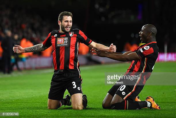Steve Cook of Bournemouth celebrates scoring his team's first goal with his team mate Benik Afobe during the Barclays Premier League match between...