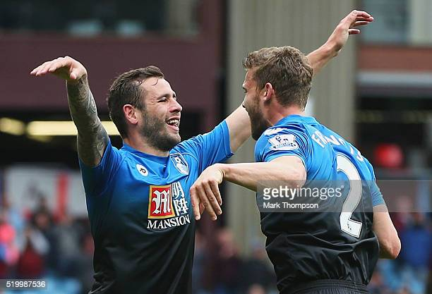 Steve Cook of Bournemouth celebrates scoring his team's first goal with his team mate Simon Francis during the Barclays Premier League match between...