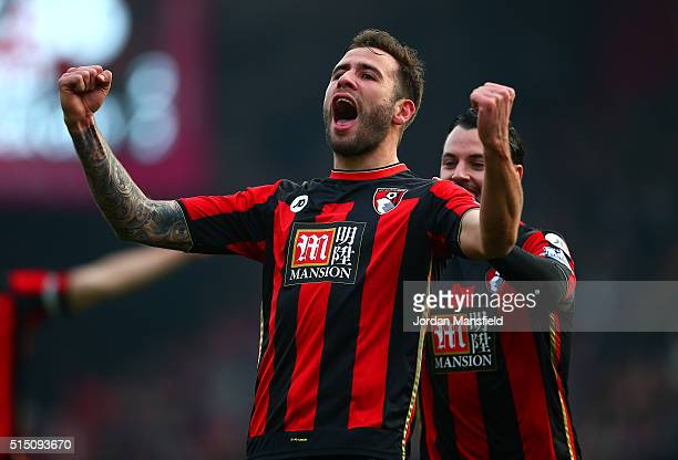 Steve Cook of Bournemouth celebrates scoring his team's third goal with his team mate Adam Smith during the Barclays Premier League match between AFC...