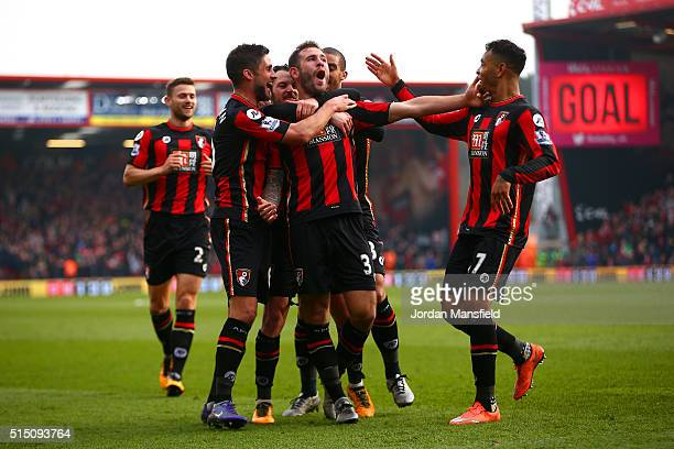 Steve Cook of Bournemouth celebrates scoring his team's third goal with his team mates during the Barclays Premier League match between AFC...