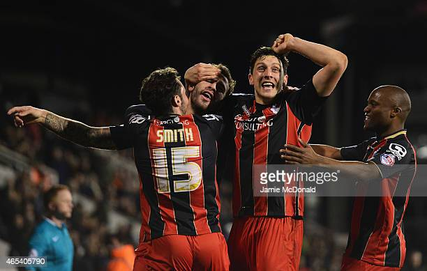 Steve Cook of Bournemouth celebrates with Adam Smith Tommy Elphick and Tokelo Rantie as he scores their fifth goal during the Sky Bet Championship...