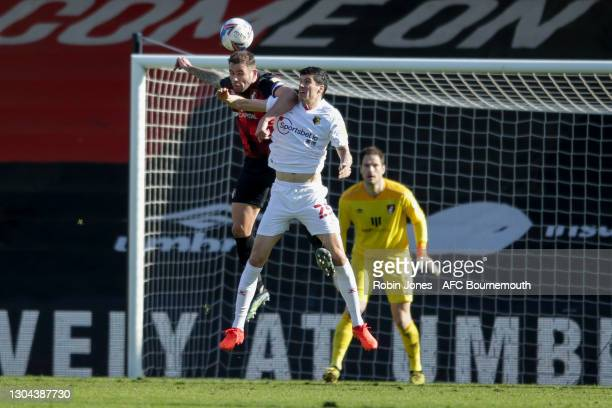 Steve Cook of Bournemouth heads clear from Stipe Perica of Watford during the Sky Bet Championship match between AFC Bournemouth and Watford at...