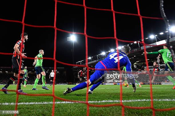 Steve Cook of Bournemouth scores his team's first goal during the Barclays Premier League match between AFC Bournemouth and Southampton at Vitality...