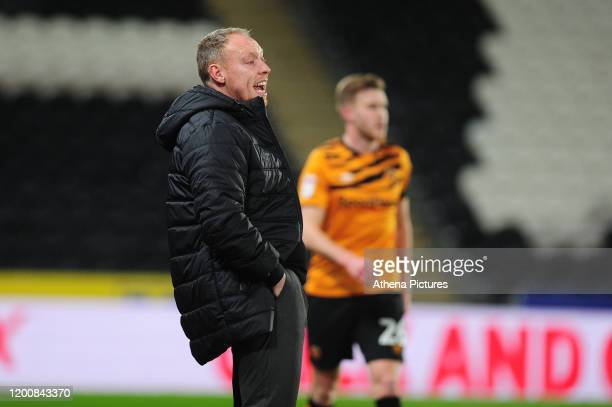 Steve Cooper Head Coach of Swansea City shouts instructions to his team from the dug-out during the Sky Bet Championship match between Hull City and...