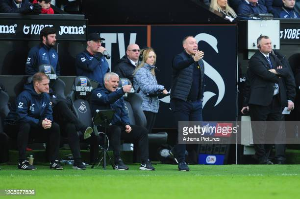 Steve Cooper Head Coach of Swansea City shouts instructions to his team from the dugout during the Sky Bet Championship match between Swansea City...