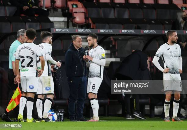 Steve Cooper, Manager of Swansea City talks with Matt Grimes of Swansea City during the Sky Bet Championship match between AFC Bournemouth and...
