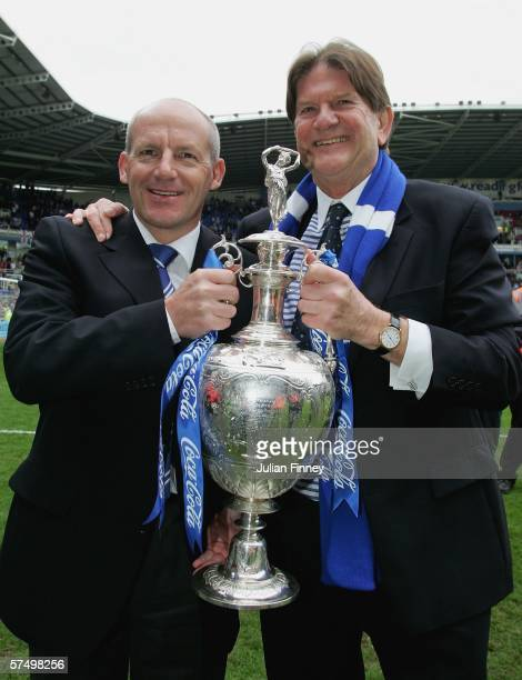 Steve Coppell manager of Reading and John Madejski Chairman of Reading celebrate winning the Championship League with the trophy after the CocaCola...