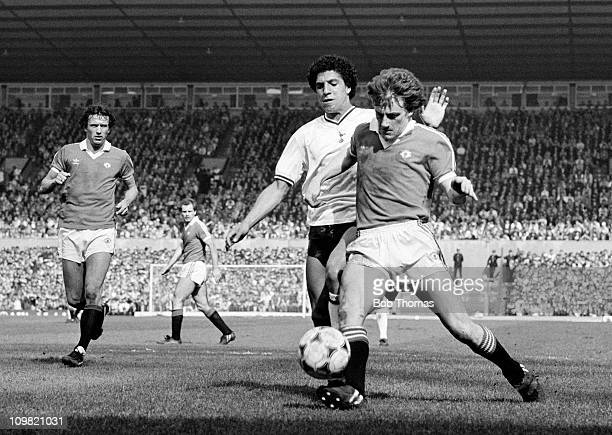 Steve Coppell of Manchester United is challenged by Chris Hughton of Tottenham Hotspur during their Division One match at Old Trafford Manchester on...
