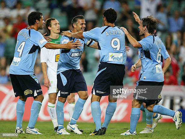 Steve Corica of Sydney celebrates with Alex Brosque and John Aloisi after scoring a goal during the round 17 ALeague match between Sydney FC and the...