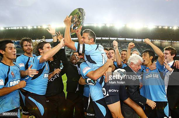 Steve Corica of Sydney celebrates with the minor premiership trophy after the round 27 ALeague match between Sydney FC and the Melbourne Victory at...