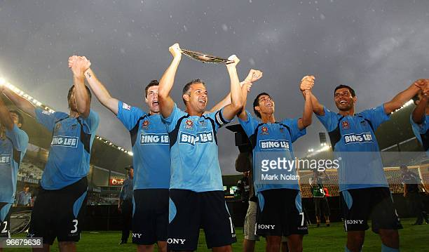 Steve Corica of Sydney holds the Minor Premiership trophy as Sydney salute the crowd after the round 27 ALeague match between Sydney FC and the...