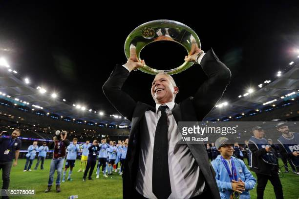 Steve Corica senior coach of Sydney FC holds the trophy aloft for fans after the 2019 ALeague Grand Final match between the Perth Glory and Sydney FC...