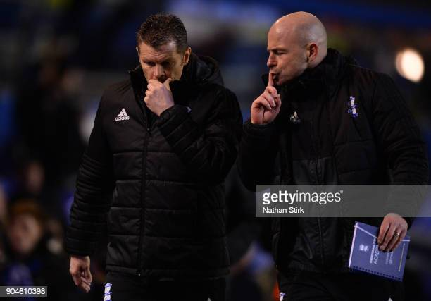 Steve Cotterill manager and Lee Carsley assistant manger of Birmingham City walk back to the tunnel after the Sky Bet Championship match between...