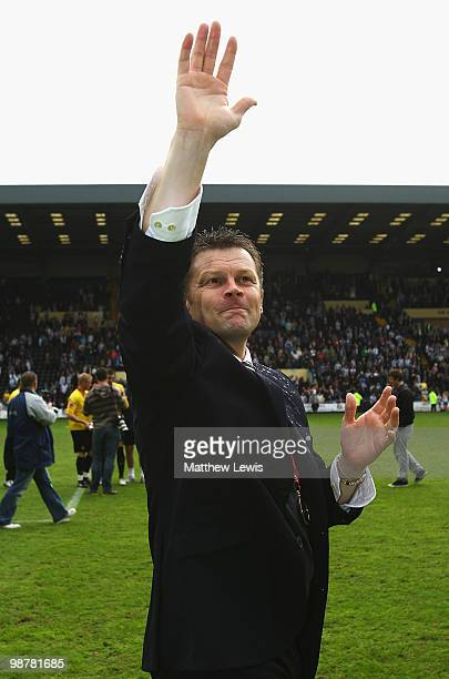 Steve Cotterill manager of Notts County celebrates winning the CocaCola League Two Championship after the CocaCola League Two match between Notts...