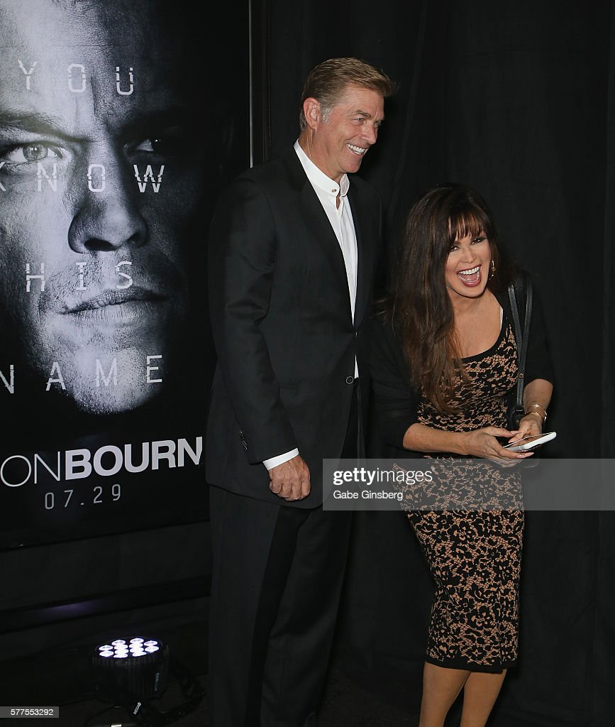 Steve Craig (L) and his wife, entertainer Marie Osmond, record video as they attend the premiere of Universal Pictures' 'Jason Bourne' at The Colosseum at Caesars Palace on July 18, 2016 in Las Vegas, Nevada.