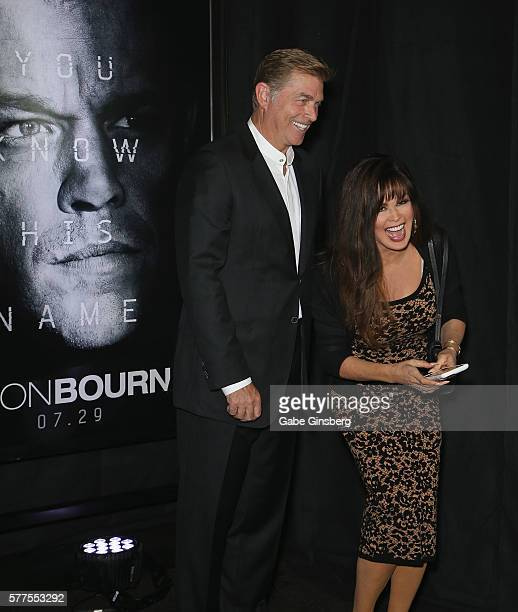 Steve Craig and his wife entertainer Marie Osmond record video as they attend the premiere of Universal Pictures' 'Jason Bourne' at The Colosseum at...