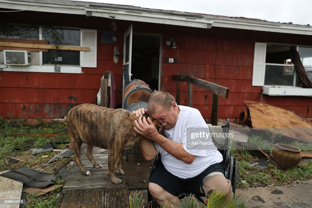 Steve Culver cries with his dog Otis as he talks about what he said was the, 'most terrifying event in his life,' when Hurricane Harvey blew in and destroyed most of his home while he and his wife took shelter there on August 26, 2017 in Rockport, Texas. Harvey made landfall shortly after 11 p.m. Friday, just north of Port Aransas as a Category 4 storm and is being reported as the strongest hurricane to hit the United States since Wilma in 2005. Forecasts call for as much as 30 inches of rain to fall in the next few days