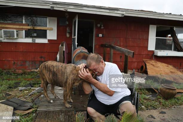 Steve Culver cries with his dog Otis as he talks about what he said was the 'most terrifying event in his life' when Hurricane Harvey blew in and...