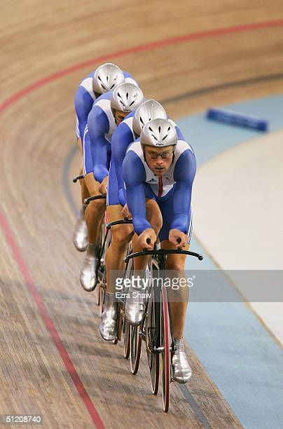 Steve Cummings, Paul Manning, Chris Newton and Bradley Wiggins of Great Britain compete in the men's track cycling team pursuit final on August 23,...