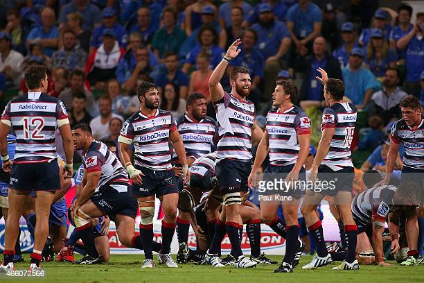 Steve Cummins and Mike Harris of the Rebels celebrate winning the round five Super Rugby match between the Force and the Rebels at nib Stadium on...