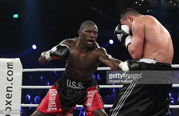 Steve Cunningham of United States punches Enad Licina of Germany during the IBF cruiserweight title fight between Steve Cunningham of the United...