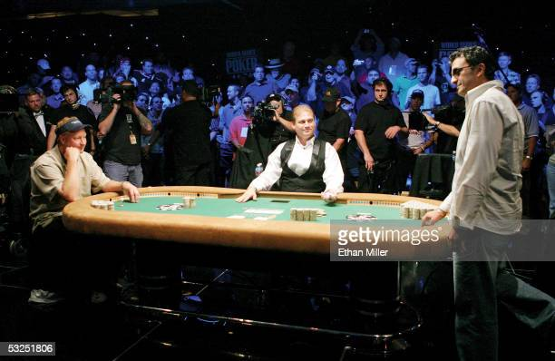 Steve Dannenmann of Maryland watches as Australian Joseph Hachem decides what to do before the last card is turned over on the final hand of the...