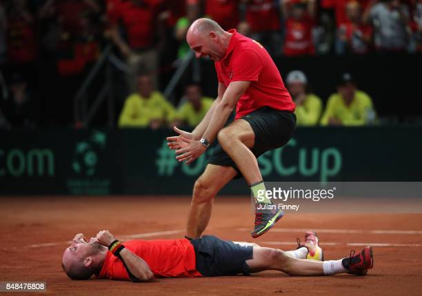 Steve Darcis of Belgium celebrates defeating Jordan Thompson of Australia with Captain Johan Van Herck of Belgium during day three of the Davis Cup...