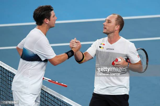 Steve Darcis of Belgium is congratulated by Cameron Norrie of Great Britain after winning their Group C singles match during day three of the 2020...