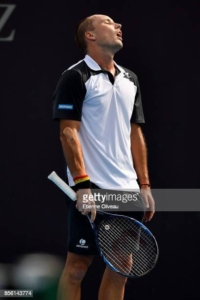 Steve Darcis of Belgium reacts after losing a point to Peter Polansky of Canada during their first round match on day two of the 2017 China Open at...