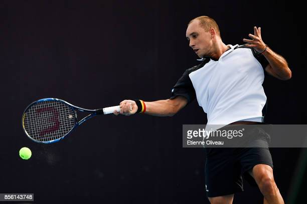 Steve Darcis of Belgium returns a shot against Peter Polansky of Canada during their first round match on day two of the 2017 China Open at the China...